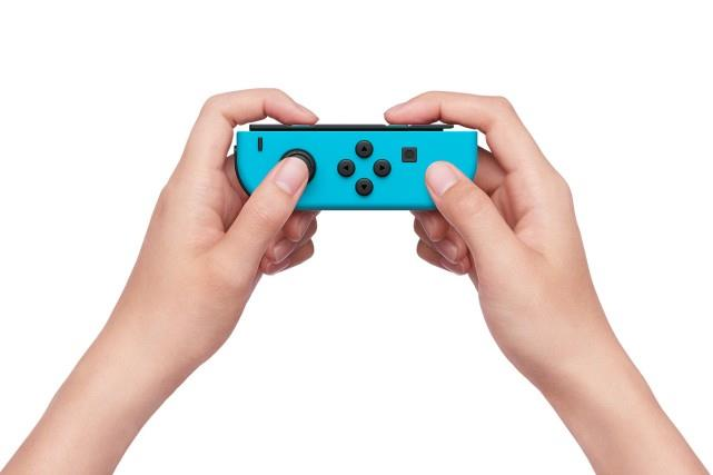 Nintendo Switch 32gb Spelcomputer Console (Rood Blauw) Foto 7